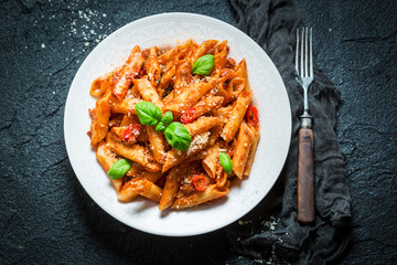 Delicious pasta bolognese with parmesan and basil