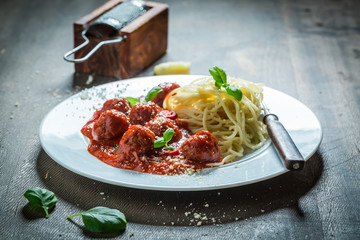 Spicy spaghetti bolognese with meatballs and parmesan