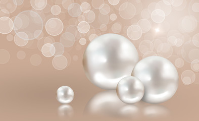 Four white pearls on peach shimmering light background