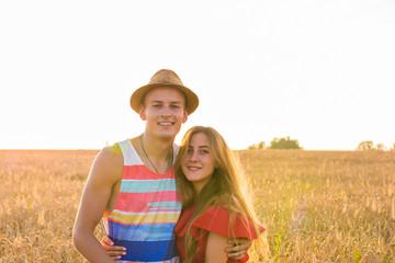 portrait of romantic couple embraces in the field