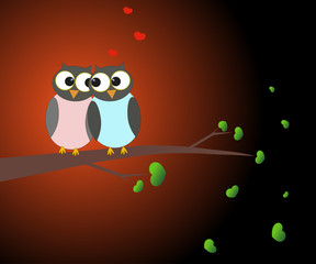 Two love owls on a tree branch in the moonlight. Love and romance.