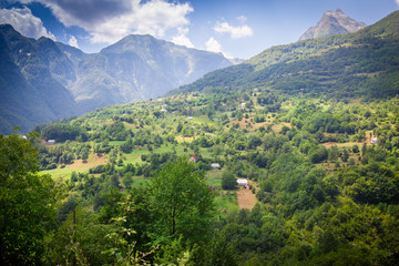 landscape of the mountains with a small farm