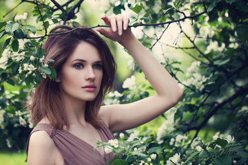 Pretty Woman in Apple Tree Flowers