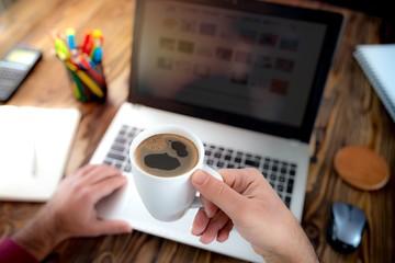 Man Drinking Coffee In Office