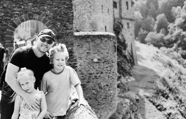 Portrait of father hiking with two kids in Germany