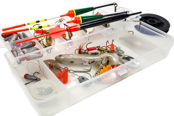 Fishing tools in storage box on white background