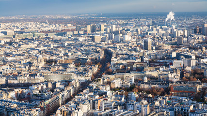 above view of large Paris city in winter twilight