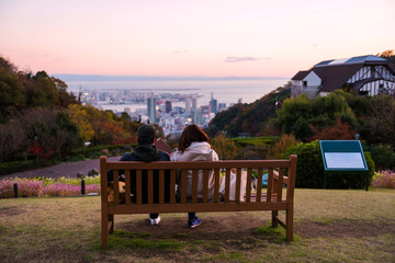 Couple at Kobe mountain for cityscape view