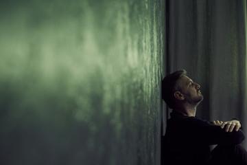 Man in gloomy room