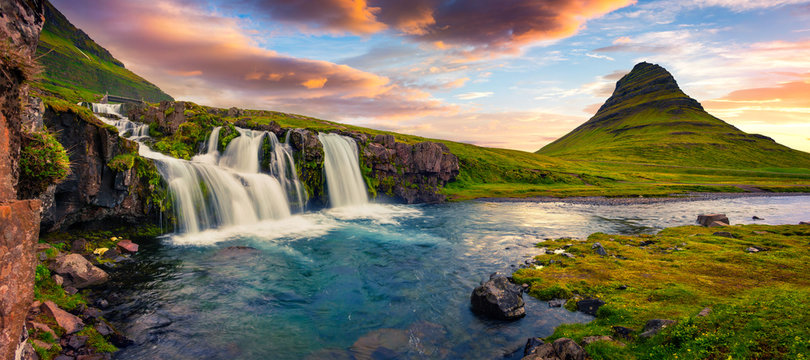 Summer sunset on famous Kirkjufellsfoss Waterfall and Kirkjufell