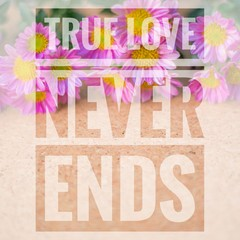 True love never ends words on pink and wooden background.
