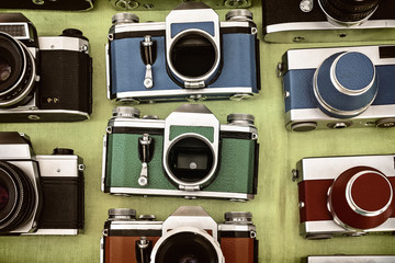 Retro styled image of photo cameras on a flee market