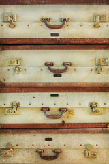 Pile of antique weathered suitcases