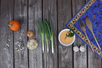 Pumpkin soup in Russian folk art khokhloma bowl with vegetables