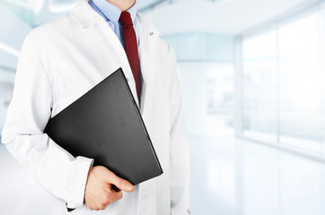 Doctor with documents in hospital