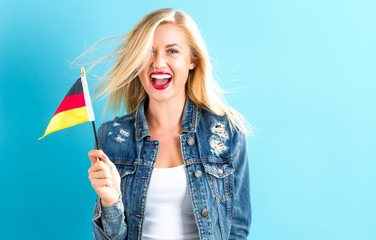 Young woman holding German flag
