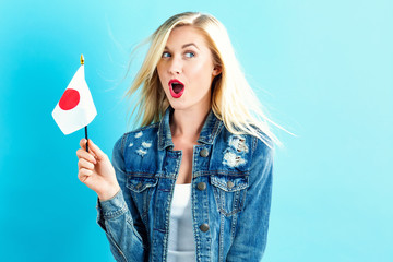 Young woman holding Japanese flag