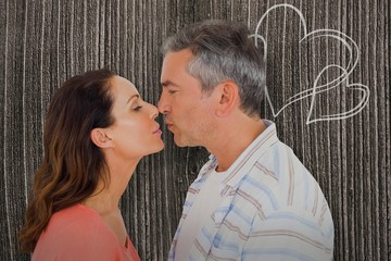 Composite image of profile view of couple about to kiss