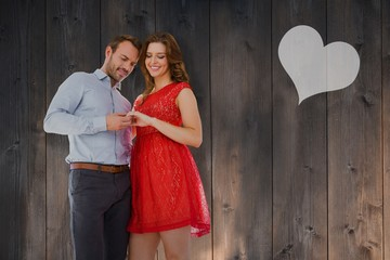 Composite image of young couple holding hands