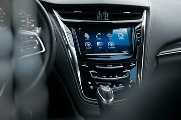 Dashboard, steering wheel, digital display and control buttons in the new luxury car.