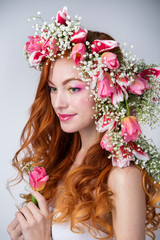 woman with red hair wearing a wreath of tulips