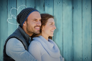 Composite image of happy young couple looking away