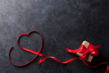 Valentines day. Heart shaped red ribbon and gift