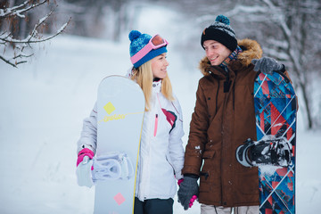 young girl and man with snowboard