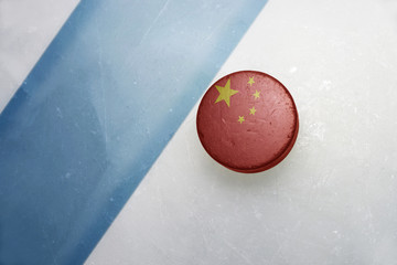 old hockey puck with the national flag of china.