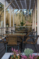 Street cafe with wicker furniture