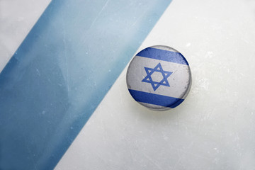 old hockey puck with the national flag of israel.