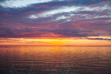 Amazing gold orange sky and water of Baltic sea at sunset