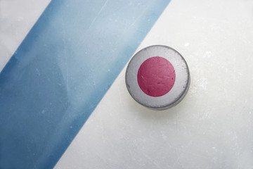 old hockey puck with the national flag of japan.