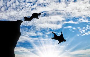 Men in suits for a wingsuit jump with mountains against sky