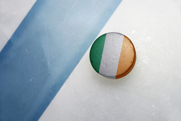 old hockey puck with the national flag of ireland.