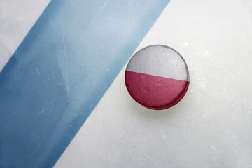 old hockey puck with the national flag of poland .