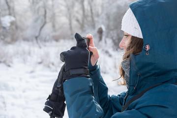 Outdoor girl take photos in winter nature