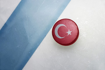 old hockey puck with the national flag of turkey.