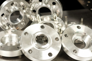 Metal mold of wheel spacers and bolts. CNC industry
