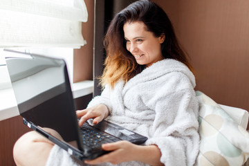A woman working on the computer at home