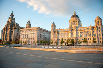 Liverpool city centre - Three Graces, buildings on Liverpool's waterfront at dusk, UK. Liverpool, in North West England, is a major city and metropolitan borough with population of 478,580 in 2015.