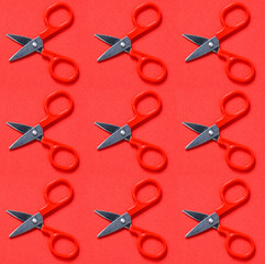 Red scissors on red background in pop art style