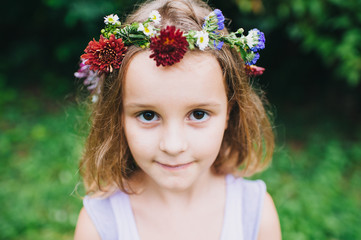 Portrait of young girl with flower headband