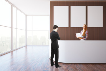 Businesspeople at reception desk
