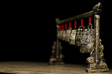 Chinese meditation bells on wooden table