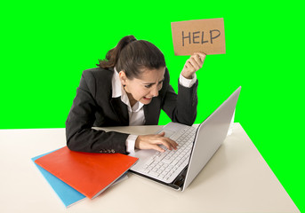 business woman working on her  laptop holding a help sign isolated on green chroma key