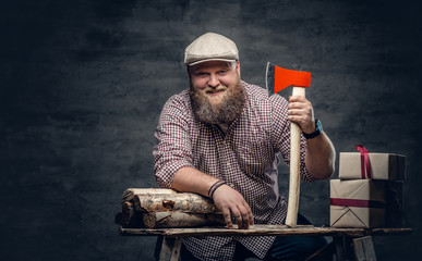 The fat bearded male holds an axe.