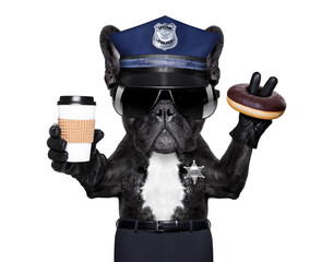 POLICE DOG ON DUTY WITH stop sign and hand , isolated on white blank background, having a meal break with donut and coffee