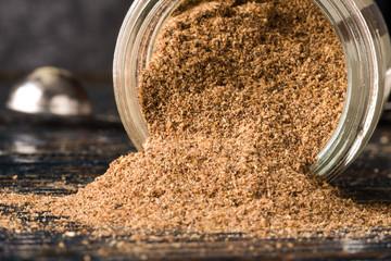 Garam Masala spilling from a spice jar