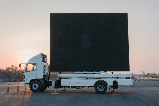 billboard on a truck LED panel for sign Advertising at twilight sky sunset background, for an advertisement